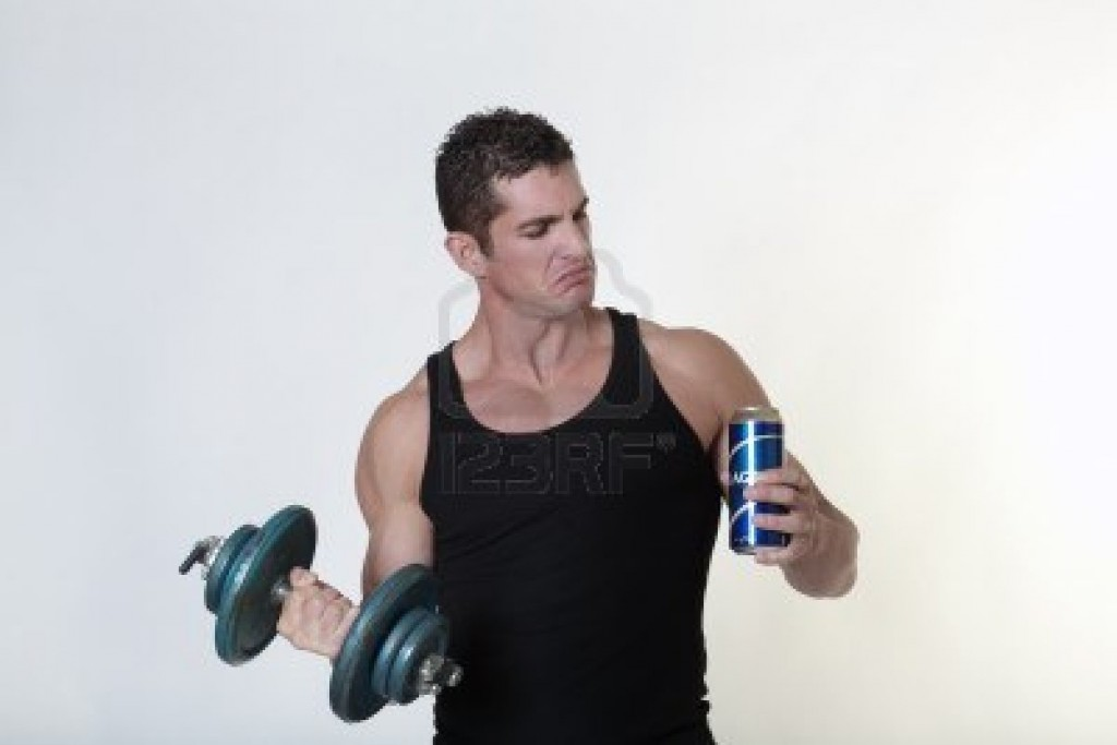 bodybuilder-not-sure-if-he-should-have-a-drink-of-beer-or-carry-on-with-his-work-out